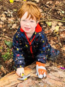 Boy with hammer at Castle Lane Forest School