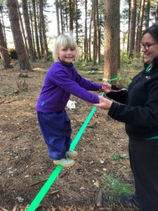 Child on rope at Castle Lane Forest School