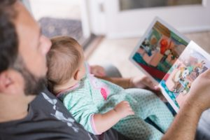 Dad and baby reading a book