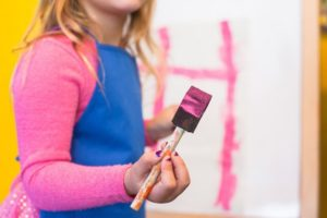 girl painting pink